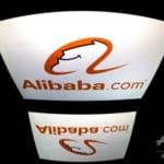 アリババが香港上場、公開価格を6%上回る初値