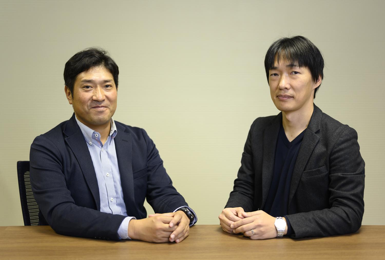 適応予測技術を開発したNEC中央研究所の吉田裕志氏(博士(工学))(右)と、NEC新事業推進本部の印南貴春氏(左)