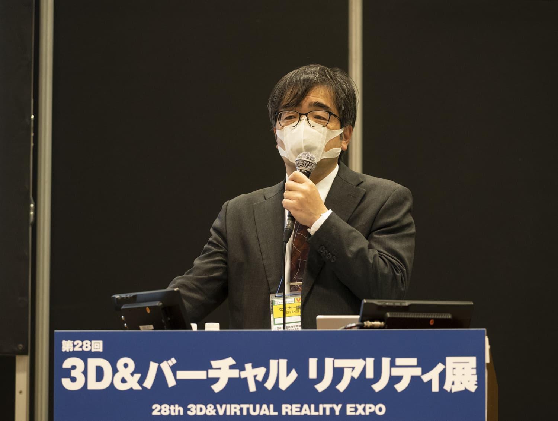 JAXAセキュリティ・情報化推進部の藤田直行氏。新型コロナウイルス感染対策のため、マスクを付けての登壇となった