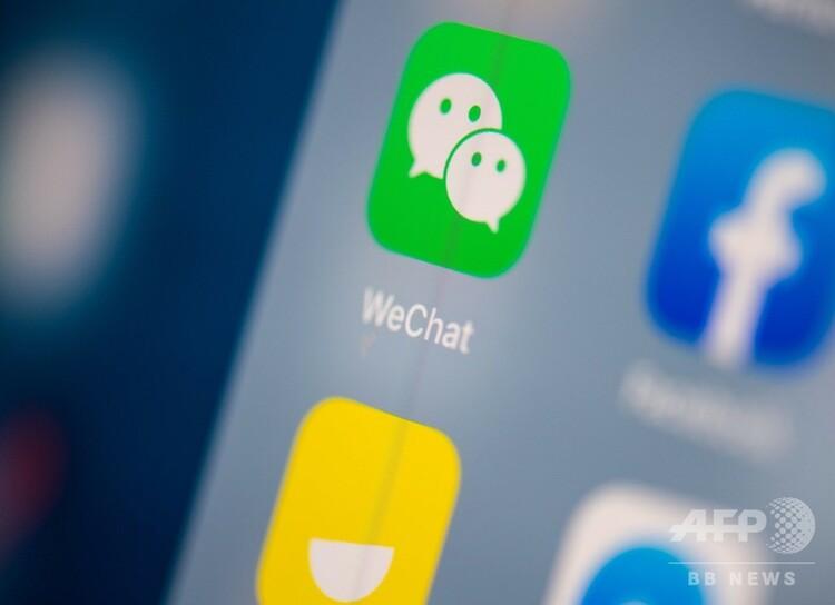 タブレットの画面に映った「微信(WeChat、ウィーチャット)」のロゴ(2019年7月24日撮影、資料写真)。(c)RICHARD A. BROOKS / AFP