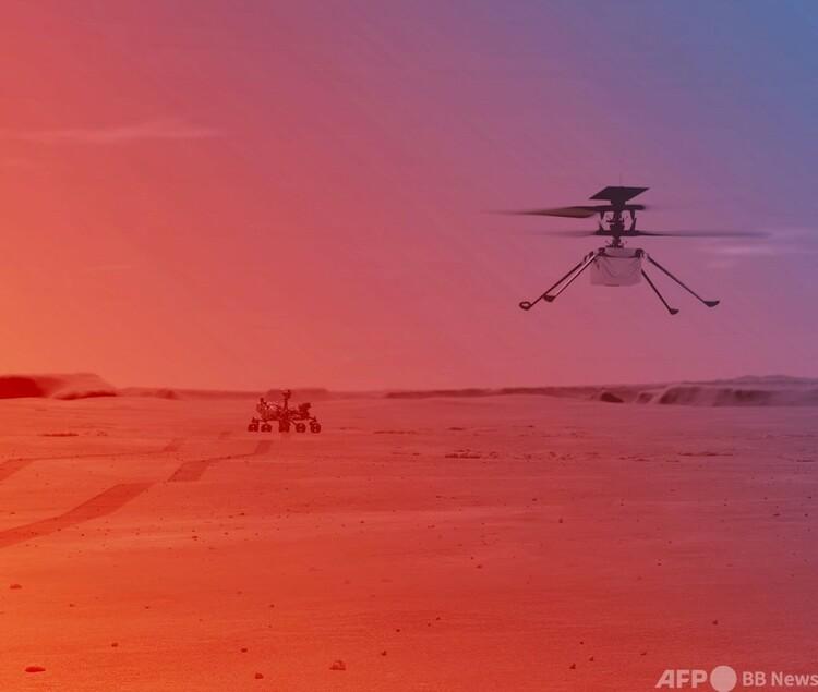 米航空宇宙局(NASA)の小型ヘリコプター「インジェニュイティ」が火星で飛行しているイメージ画(2021年3月23日提供)。(c)AFP PHOTO : NASA:JPL-Caltech:MSSS:HANDOUT