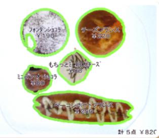 BakeryScanの画面。さまざまなパンを機械が認識して、画面上にパンの種類が表示される(ブレイン社提供)
